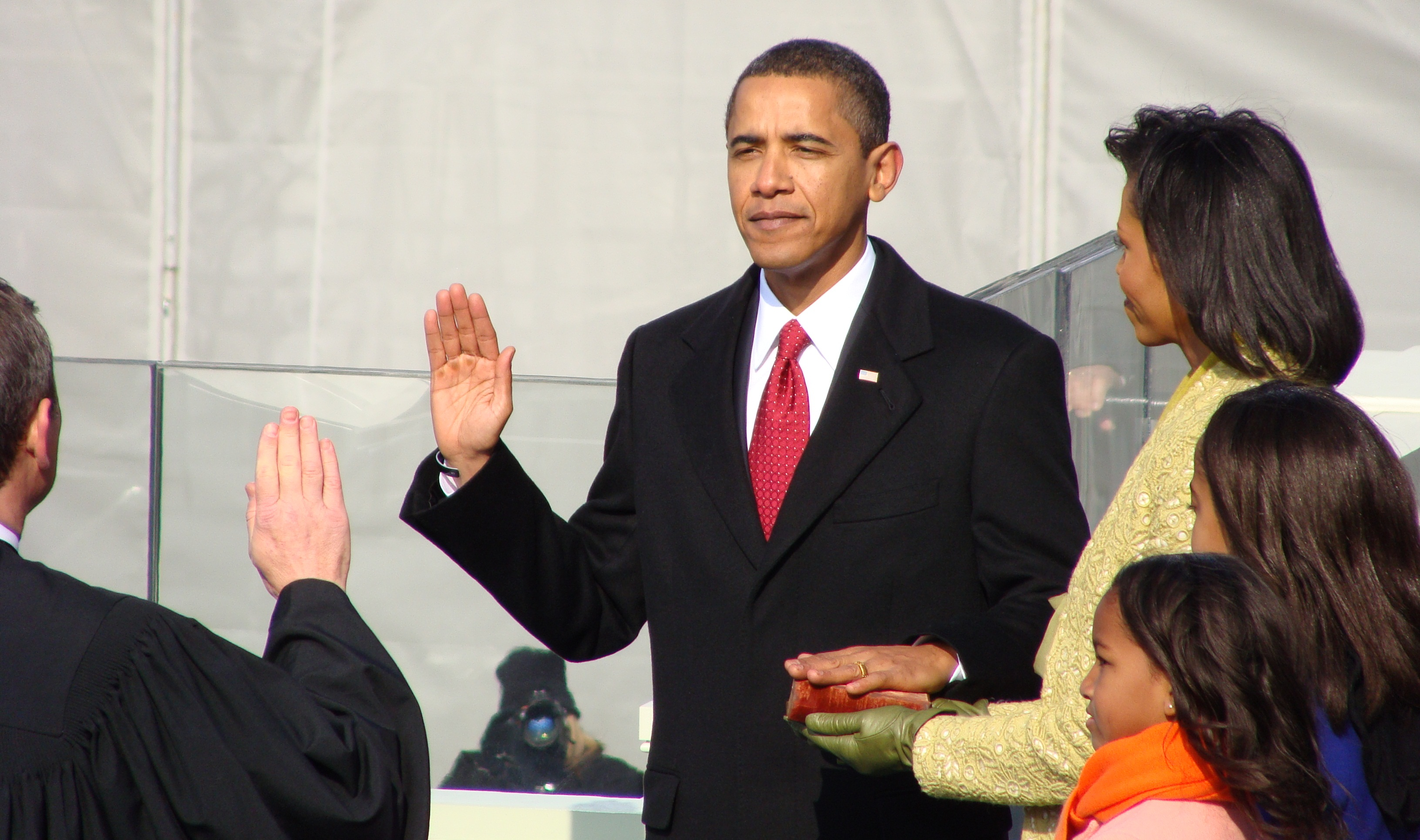 Barack Obama Being Sworn In With Hand On Lincoln's Bible