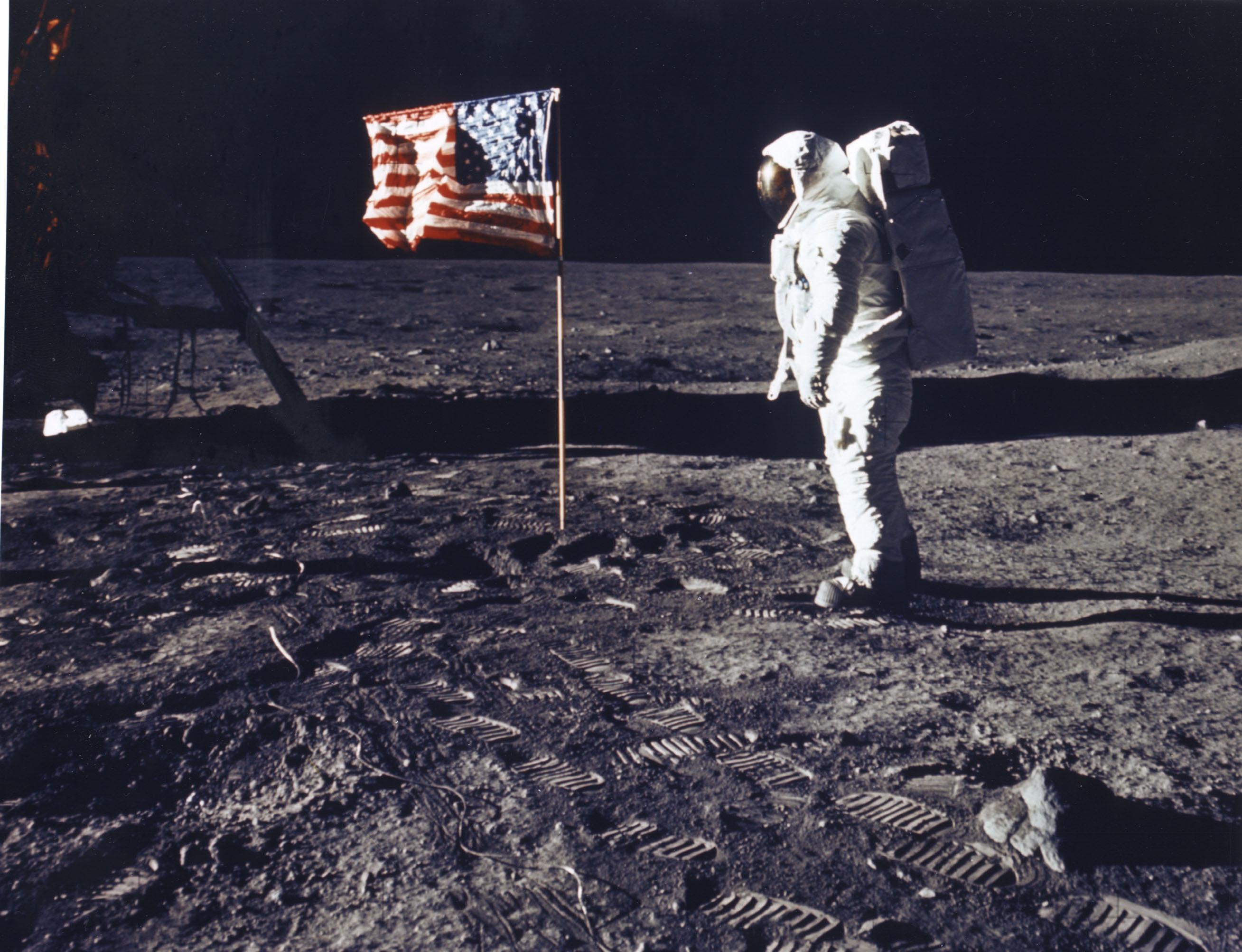 English: walks on the moon.
