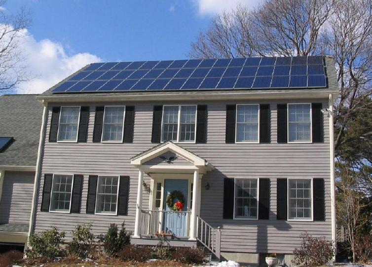 File:Solar panels on house roof winter view.jpg