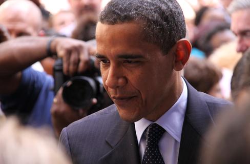 President Barack Obama talks with FBI executiv...