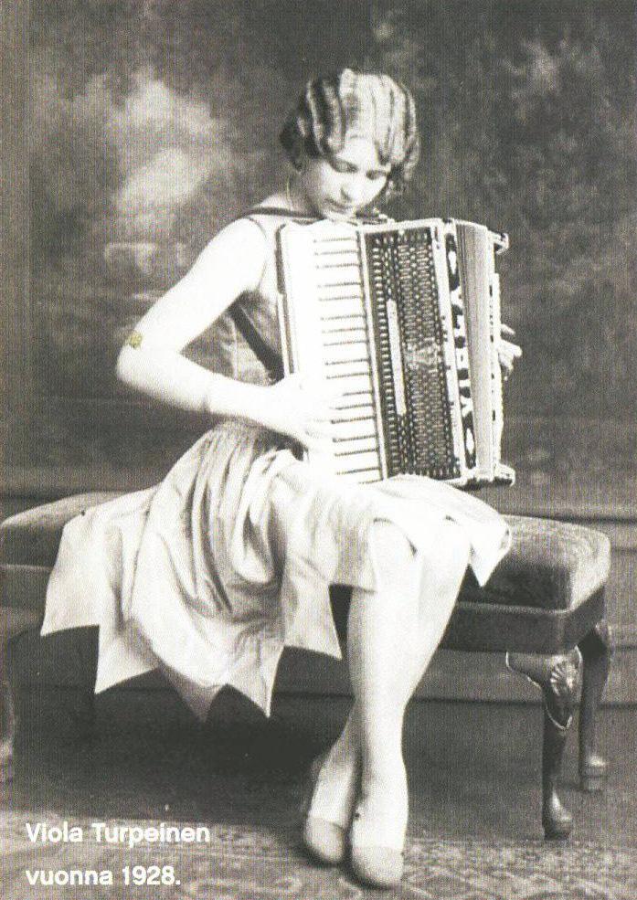 Viola Turpeinen, antique posed photo playing piano accordion