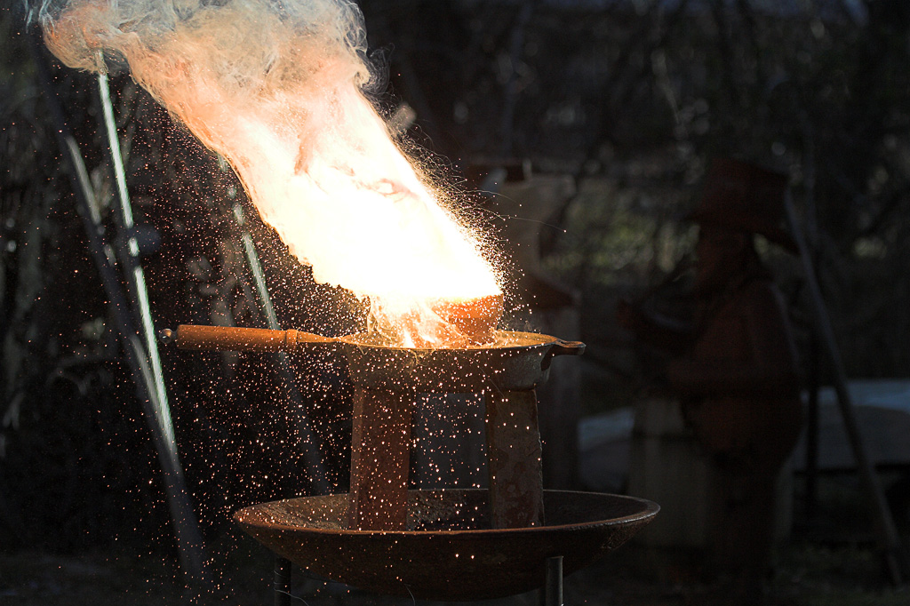 A thermite reaction taking place on a cast iro...