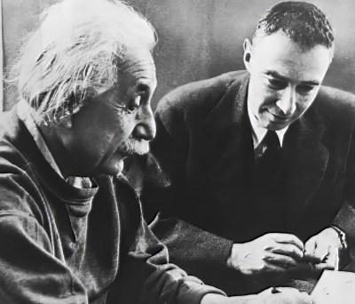 Physicists Albert Einstein and Oppenheimer conferring circa 1950