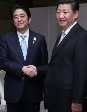 Abe and Chinese President Xi Jinping meet in Jakarta, April 2015