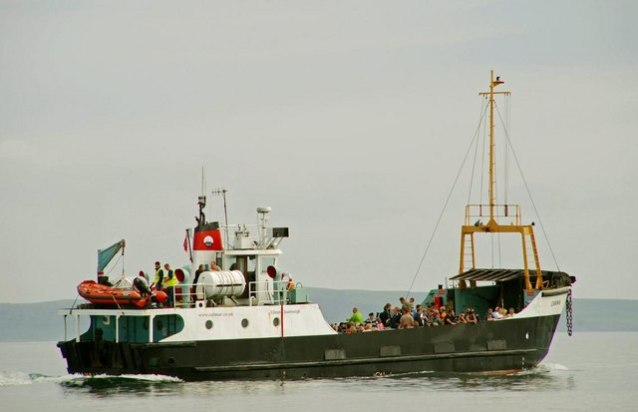 The Rathlin ferry, July 2008. Now on charter to the new operator, the Canna (with the Caledonian MacBrayne name pained out) departs Ballycastle harbour with the morning service to Rathlin.