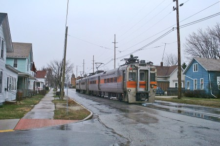 The South Shore Line running in Michigan City