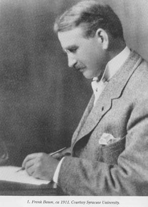 Writer L. Frank Baum, writing with pen.
