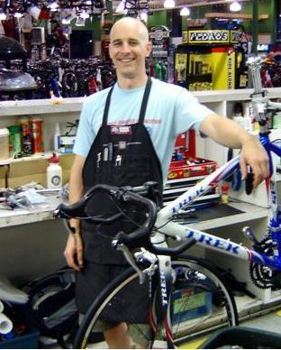 English: Bike mechanic at a local bike shop