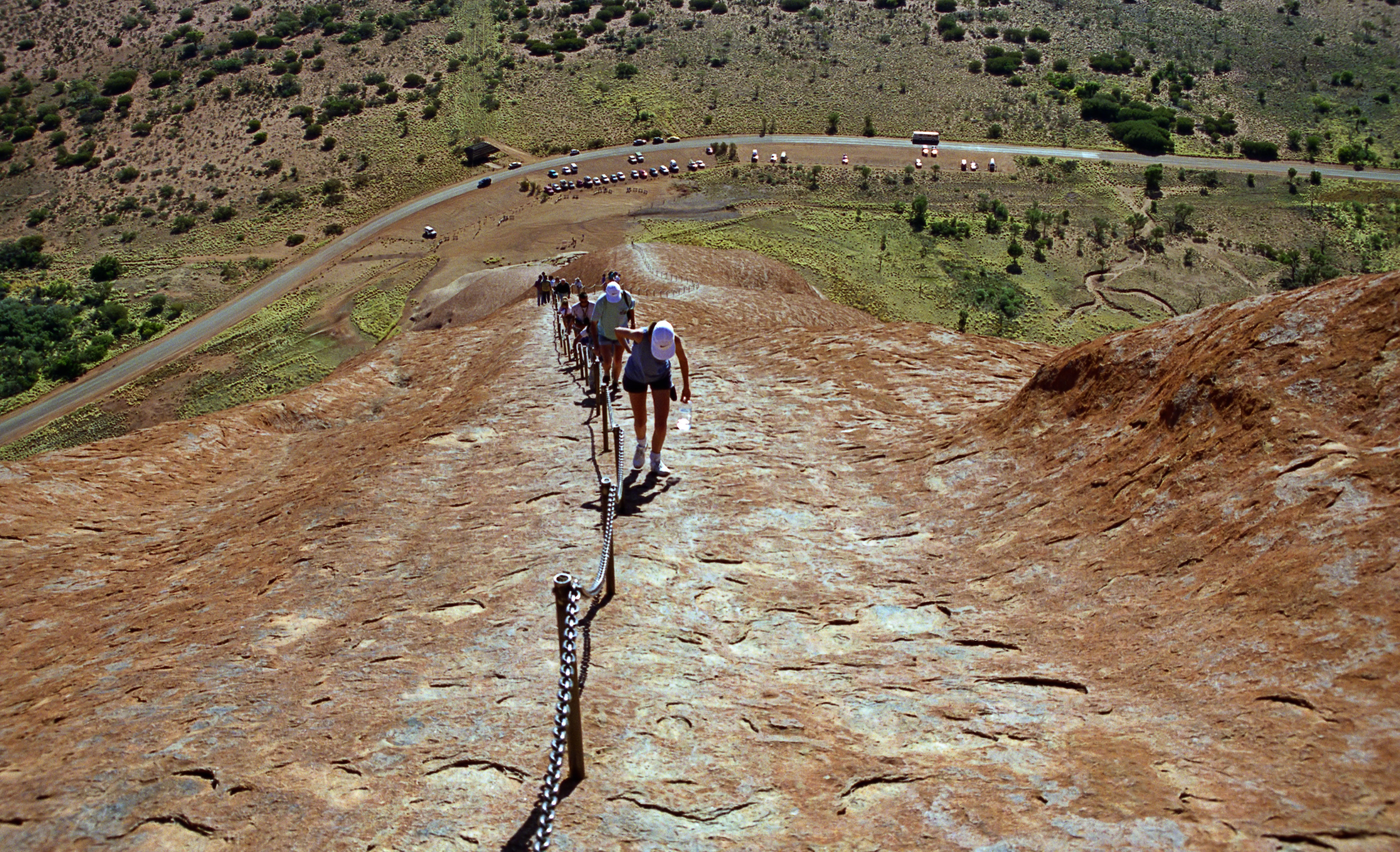 English: Looking down the trail of Ayers Rock,...