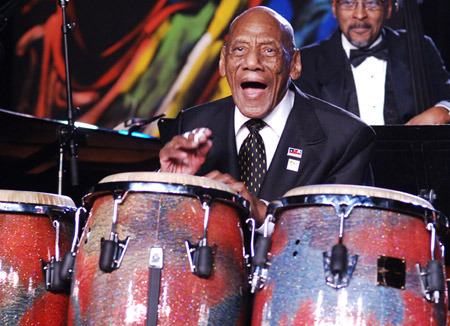 Percussionist Candido Camero playing at a conc...