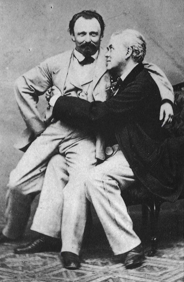https://i2.wp.com/upload.wikimedia.org/wikipedia/commons/c/c6/Men_Couple-Sit_on_my_lap-bev_1900-GHP-445446.jpg