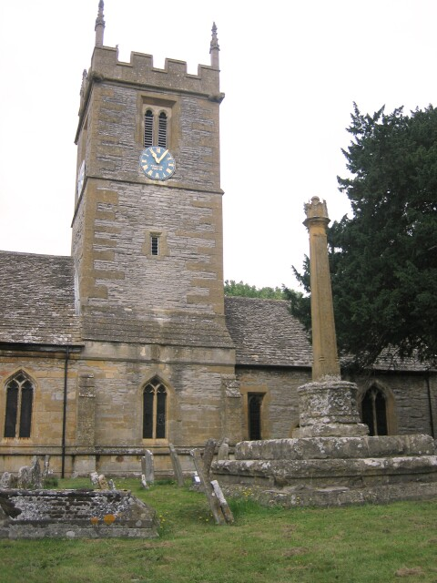 Churchyard cross (right) and central tower (centre left) of St Andrew's parish church, Hampton, Worcestershire