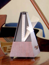 English: A metronome.