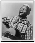 Huddie Ledbetter (Lead Belly), half-length por...