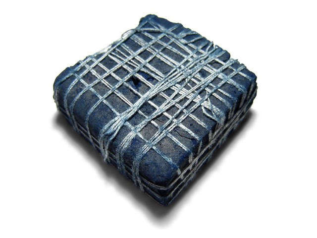 Photograph of a piece of indigo plant dye from India, c. 2.5 inches (6.35 cm) square. Image Credit : Evan Izer (Palladian)