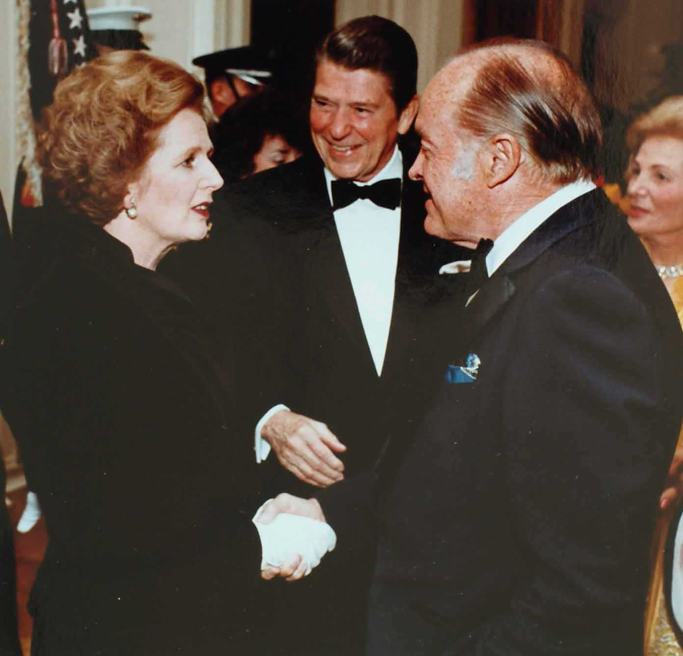 https://i2.wp.com/upload.wikimedia.org/wikipedia/commons/d/d8/Thatcher_with_Reagan_and_Bob_Hope.jpg