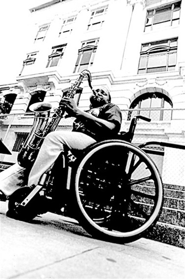 English: A sax busker on the streets of the Fr...