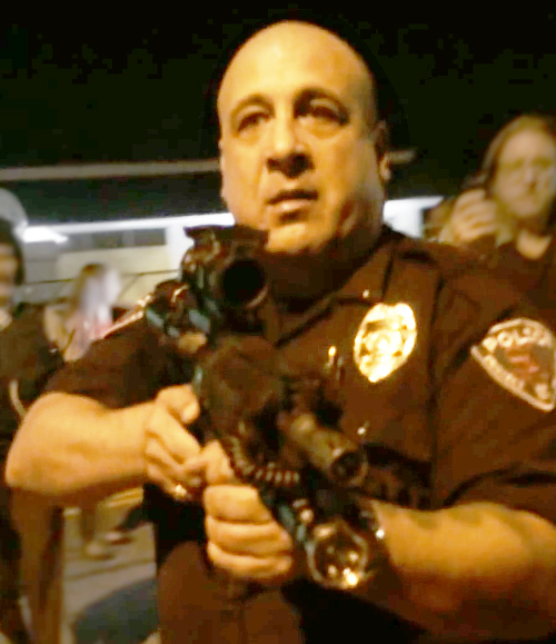 Lt. Ray Albers points rifle in Ferguson
