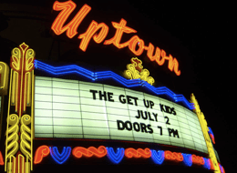 Photo of the Uptown Theater marquee on the dat...