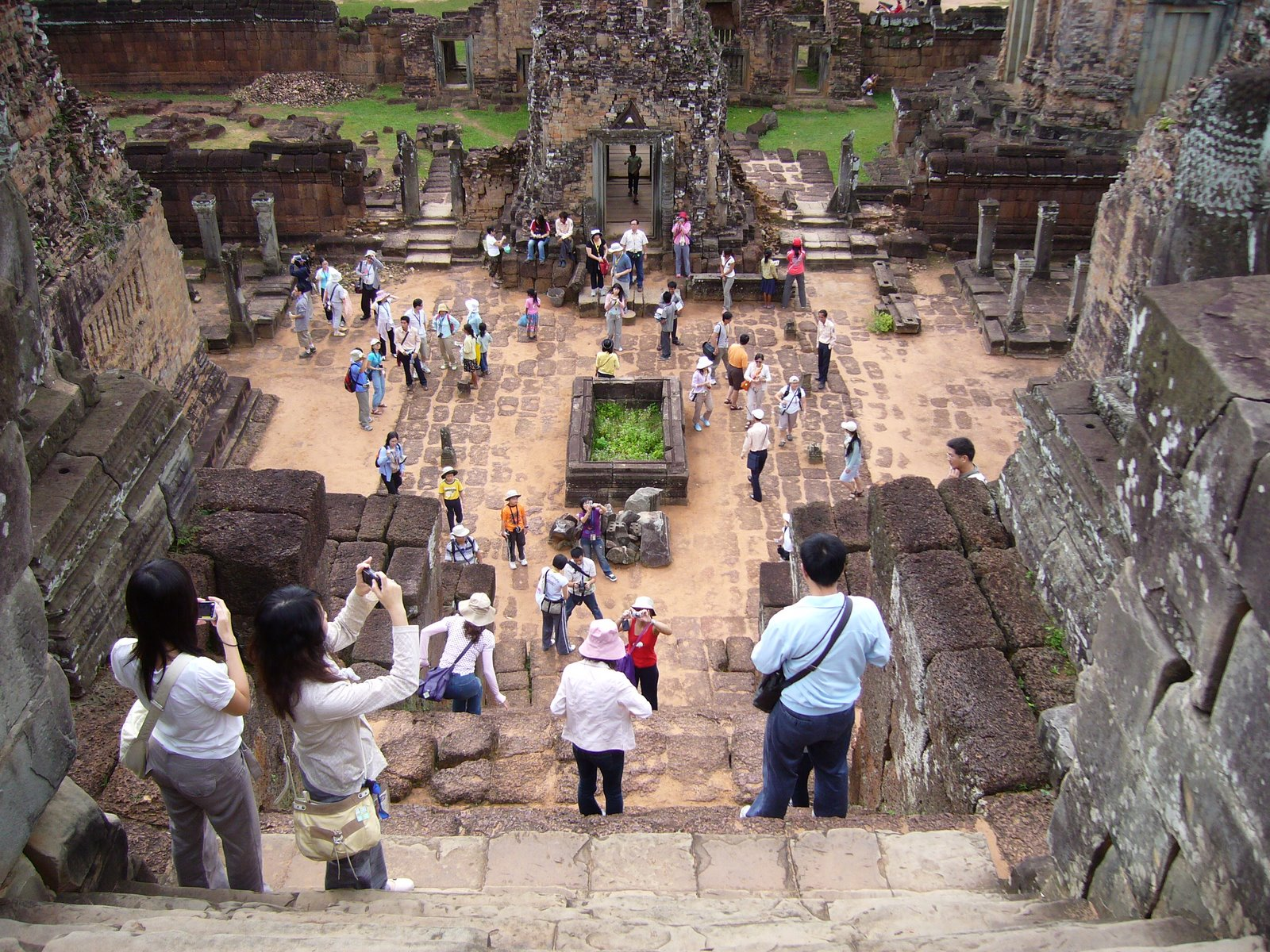 Tourists taking pictures at the khmer Pre Rup ...