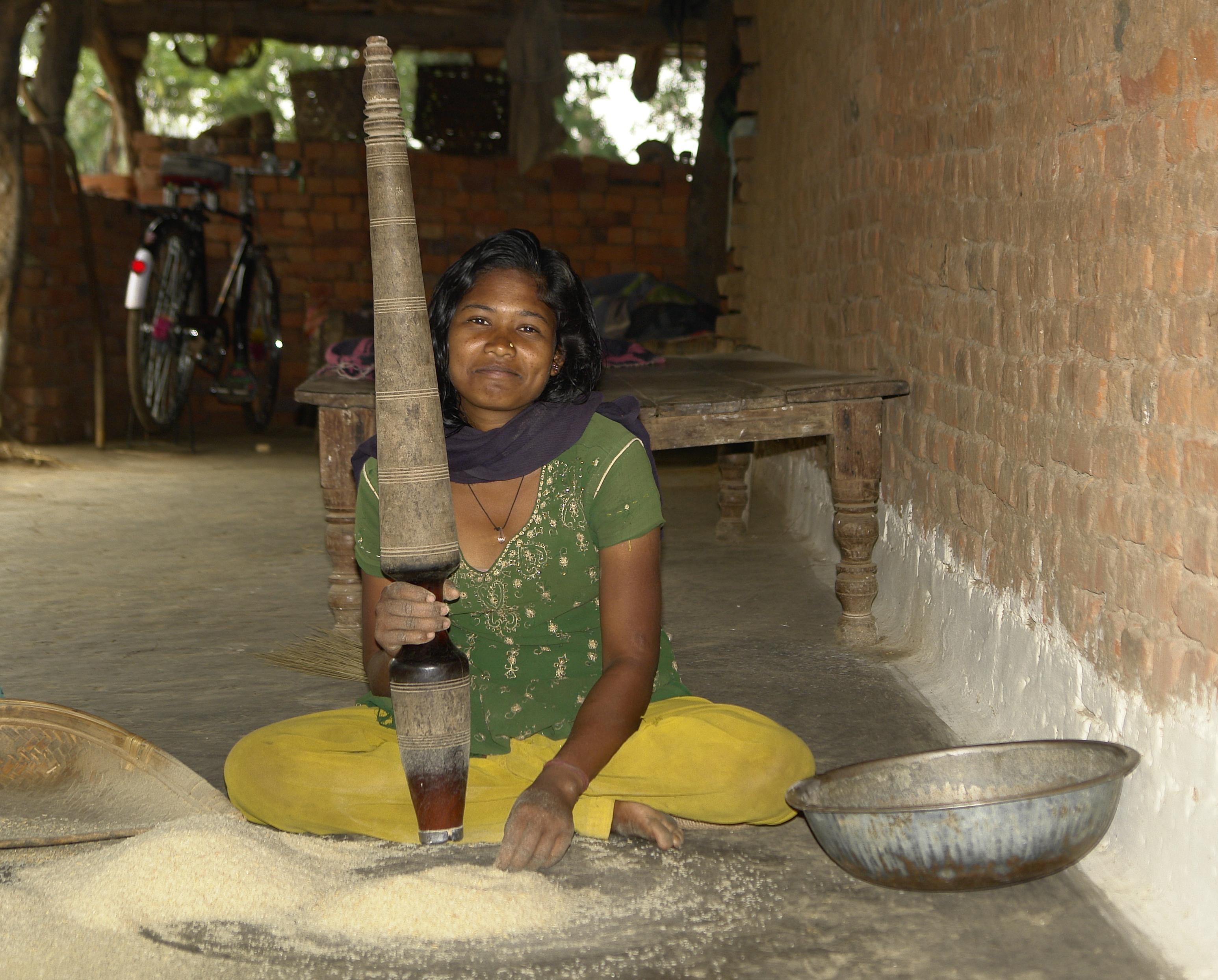 FileYoung Adivasi Woman Crushing Rice MP Indiajpg