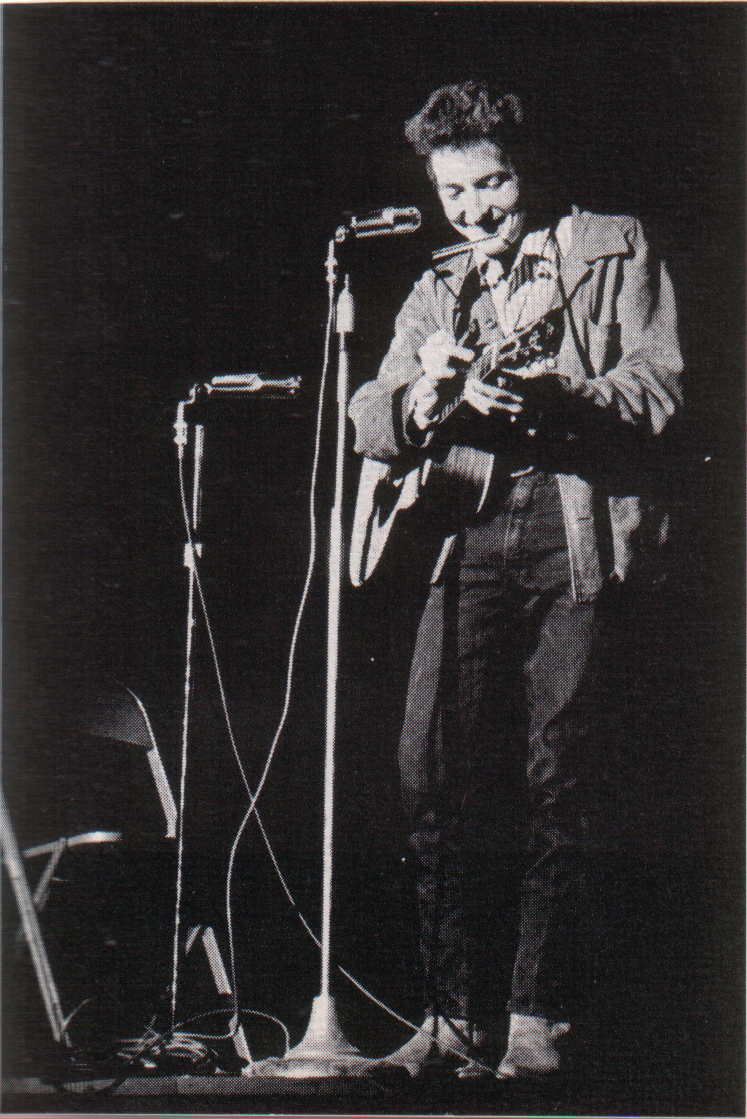 https://i2.wp.com/upload.wikimedia.org/wikipedia/commons/f/f0/Bob_Dylan_in_November_1963.jpg