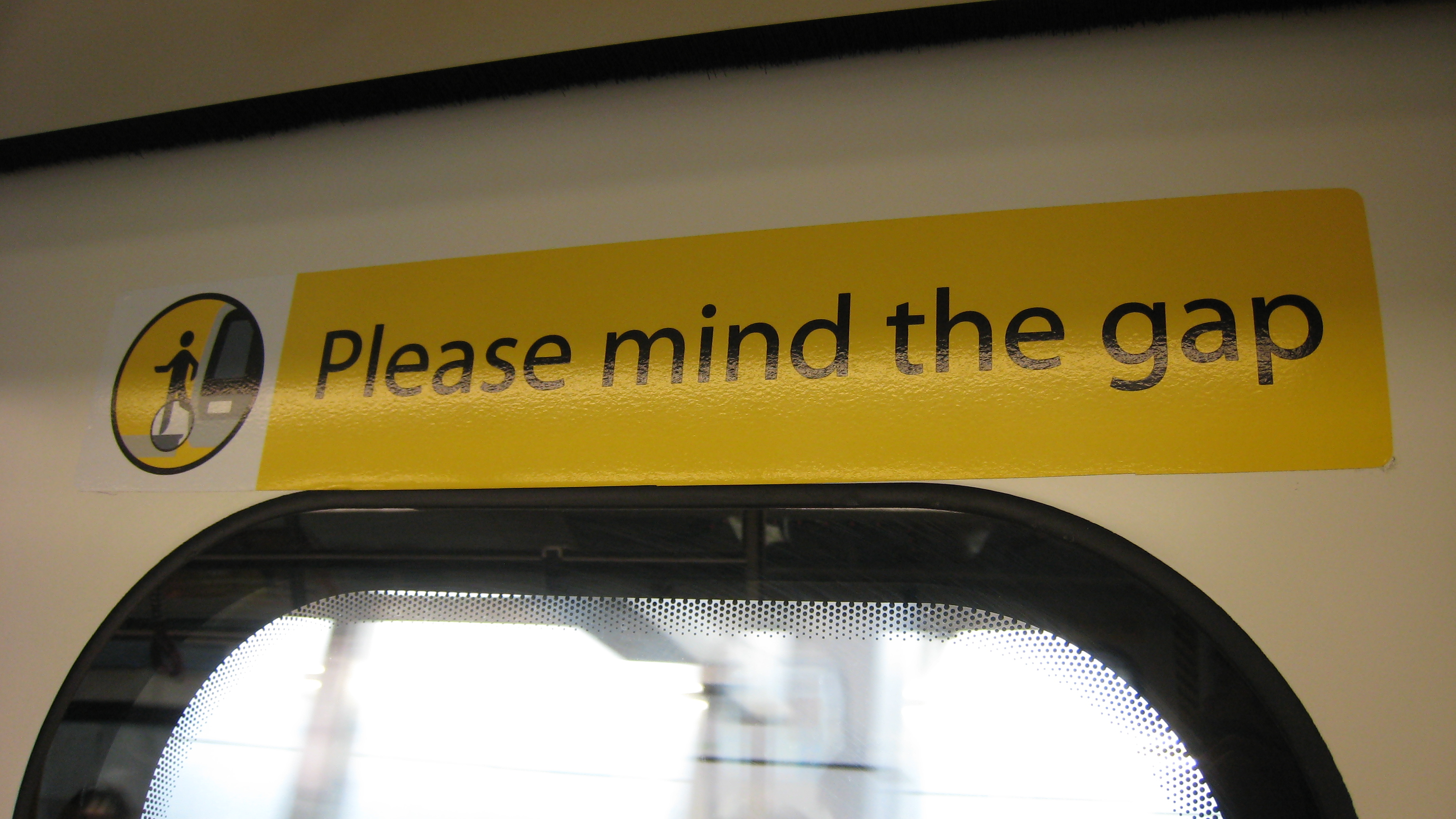 """Mind the gap"" sign on a Hong Kong MTR train"