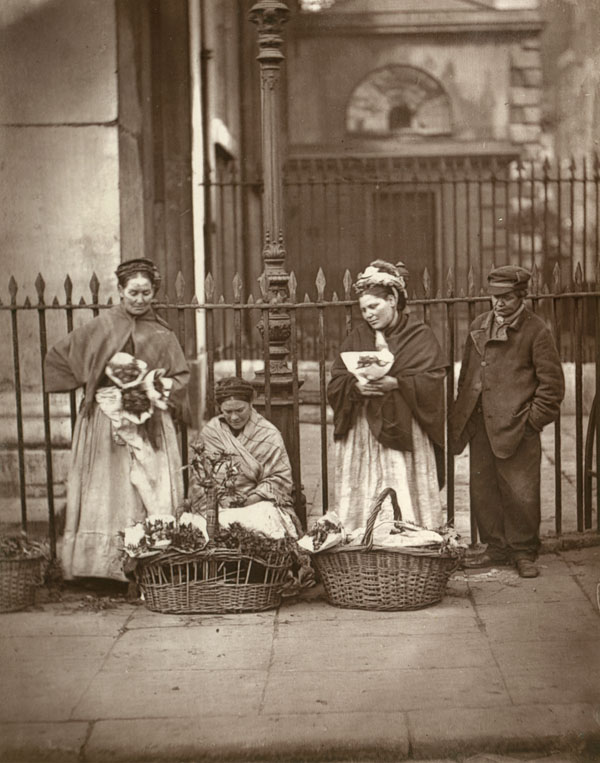 Women selling flowers on the pavement in Coven...