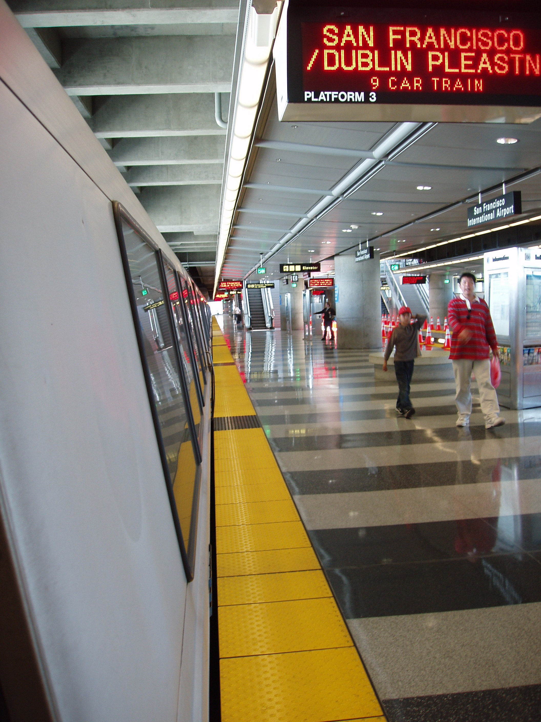 A BART Train loads passengers at SFO