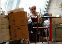 Nasseri in the airport, next to his things, in 2005