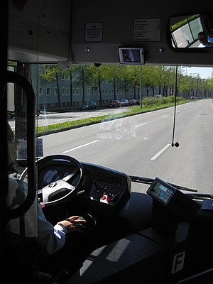 English: Person conducting a bus in Munich.
