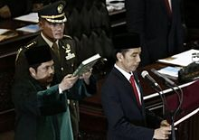 Joko Widodo taking the presidential oath of office during his inauguration on 20 October 2014