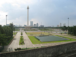 A view of Merdeka Square from Gambir Station. with National Monument standing in the middle of the Square.