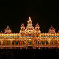 Golden 5-storey Mysore Palace building with 21 domed towers and central spire