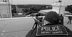 Secret Service agents positioned atop the roof...