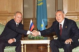 English: ALMATY. President Vladimir Putin and ...