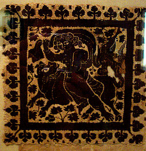 photograph of ancient textile of Zeus in the f...