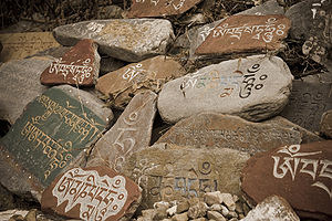 Stone tablets with prayers in Tibetan language...