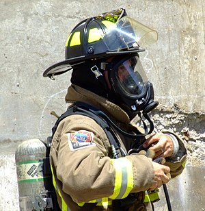 English: Toronto firefighter wearing a self-co...