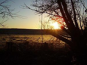 English: Christmas Dawn The sun rises late in ...