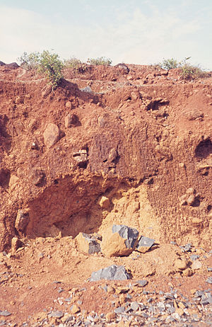 Laterite with relics of unweathered basalt. Pu...