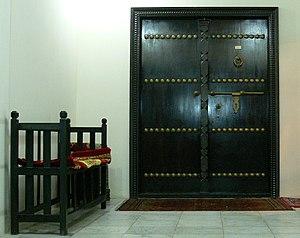 Bench and old door in Bahrain.