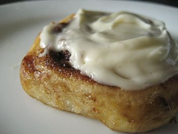 Finished cinnamon roll with glaze.