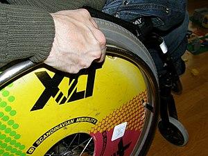 English: A close-up of a rear wheel of a wheel...