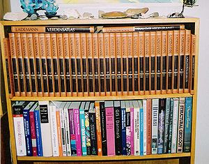 A bookshelf with an encyclopaedia and textbook...