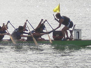 A dragon boat crossing the finish line at the ...
