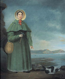 portrait of woman with bonnet, rock hammer, and small dog