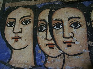 Three faces on a Wall in Bahar Dar