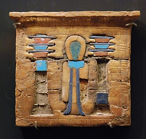 Glided and entrusted wooden pectoral; symbols ...