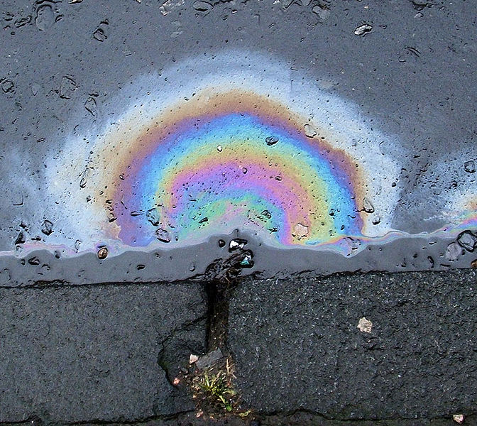 Diesel oil spill on a road - from wikipedia entry - Petroleum